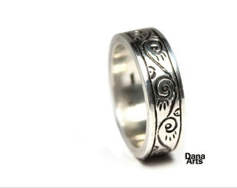 Chased silver band with swirls