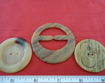 Two large vintage caramel coloured coat  buttons and a scarf or ribbon slide from the early 1900s. LB11.5-48(d)