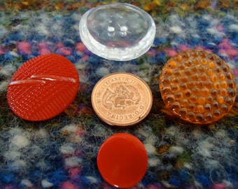 """4 Vintage glass buttons, 4 different ones, 1 Orange, 2 red, 1 clear.  All 1"""" or less across.  UNK/X11.1-3."""