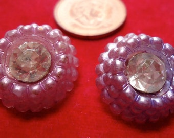 """7 Plastic vintage buttons mixed sizes from 1.75"""" to 0.64"""", styles domed, shanks and colors mauve, pink, white and amber. SLVT10.11-12.26."""