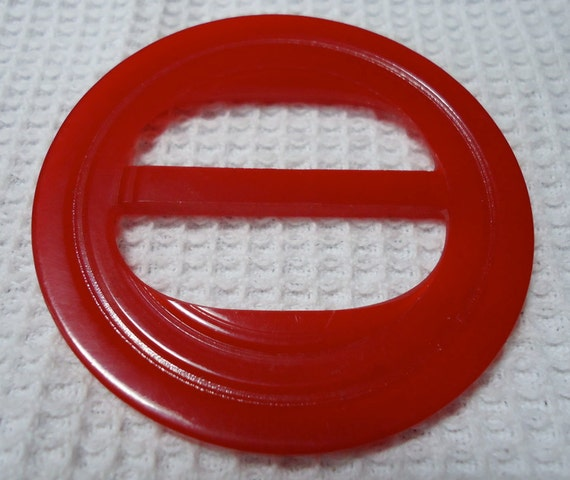 "1 large Vintage Bakelite scarf holder, ribbon slide.1.15"" across.  Red. UNK10.00-12.2-26.1"