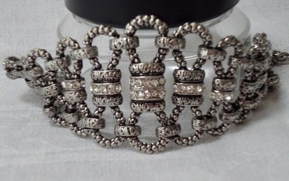 """Vintage bracelet, 'Old  Viennois' bracelet, silver toned metal, steel cut with rhinestones.  7"""" long.  STEVE12.3-17.4."""