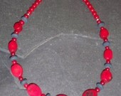 Coral and black resin necklace