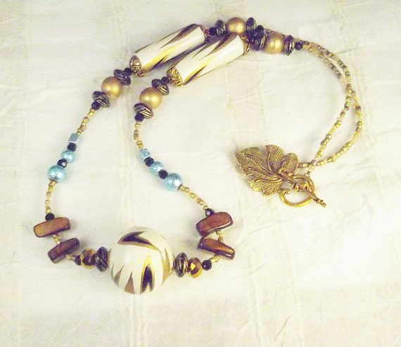 Gold, black and white, robins egg blue, wood, metal, golden abalone, glass and brass Necklace: Slightly Tribal