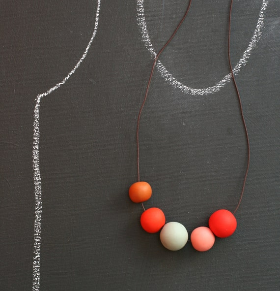 not quite round  beads make a necklace