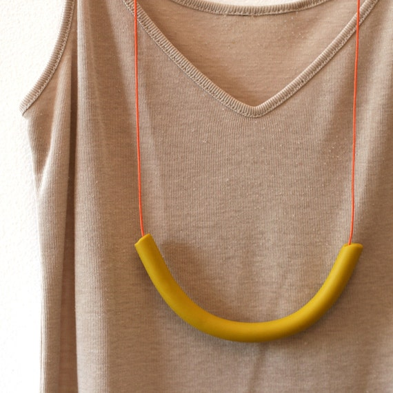 not quite a semi circle makes a necklace