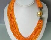 Vintage Orange Tangerine torsade bib plastic necklace 1950s