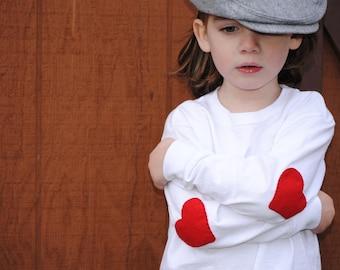 He wears his heart on his sleeve kids t-shirt