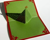 Christmas Tree 3D Pop Up Greeting Card and Decoration. Handmade Cut by Hand Origamic Architecture in Forest Green and Shimmery Bright Red.
