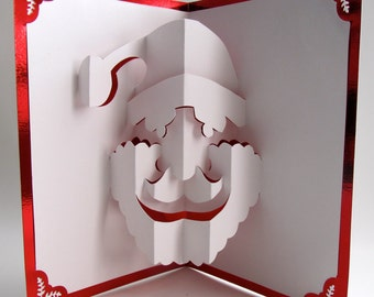 Santa Claus Christmas Pop Up Card Home Décor 3D Handmade Cut by Hand Origamic Architecture in Metallic Bright Red and White.