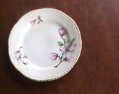 Vintage Boxxer Laughling Liberty china 6 & 1/4 inch plate with the Magonolia Dogwood design on it.