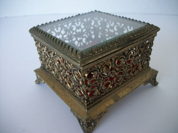 Brass jewelry box with vintage brooch
