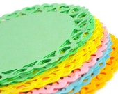 Colored round paper doilies in 4 inch with small heart design edge. Spring colors green  yellow pink blue mustard