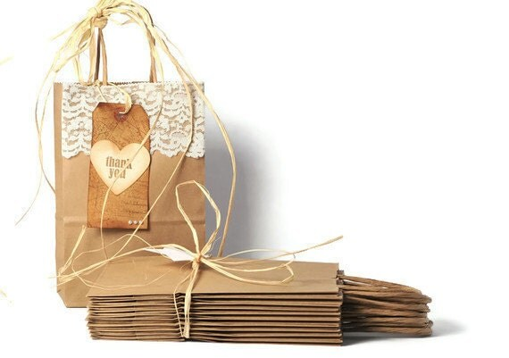 25 kraft paper bags gusseted with handles. Recycled plain brown shopping bag
