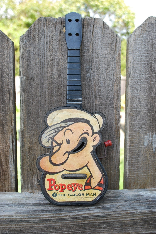 original sweepea playing guitar in 2019 | Popeye cartoon ... |Popeye Guitar