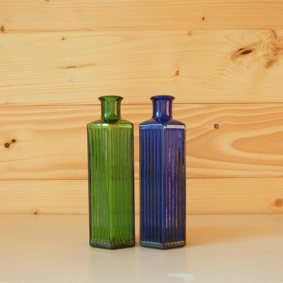 Vintage glass bottle collection, bright blue and green.