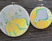 SALE . . . HAPPINESS PAIR of paintings on vintage embroidered textiles