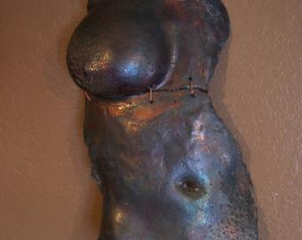 Nude Female figure in Raku, wall sculpture