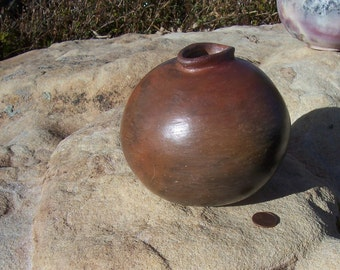 little round Barrel fired ceramic pot in red earthtones