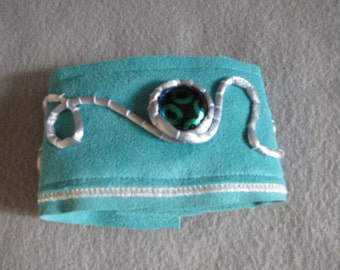 Ultrasuede cuff bracelet with glass cabachon, silver cording.