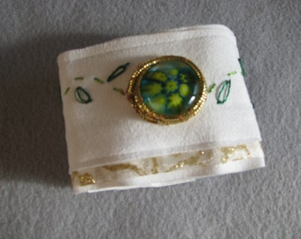 Ultrasuede embroidered cuff with millefiori glass cabachon