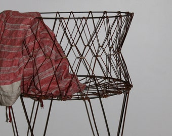 Vintage wire laundry collapsable basket on casters.