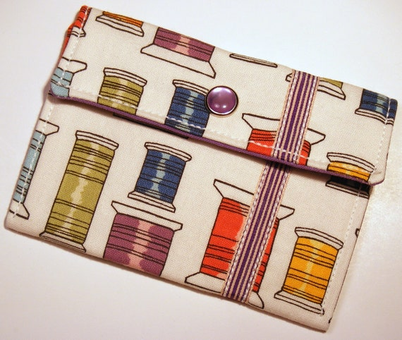 Card wallet / gift card holder in multicolored spool of thread print with purple ribbon