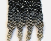 A beaded necklace I call TREMENDOUS - black, pewter, silver, dusty rose