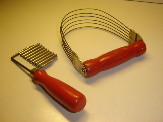Red-handled wooden kitchen utensils, vintage, circa 1940s