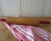 A Vintage Farmhouse Red Rolling Pin