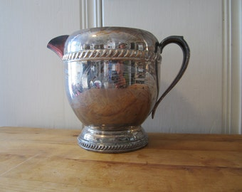 A Vintage Silver Water Pitcher NOW ON SALE