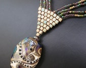 Tribal- a multi-strand necklace with lampwork focal bead