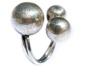 Three balls ring