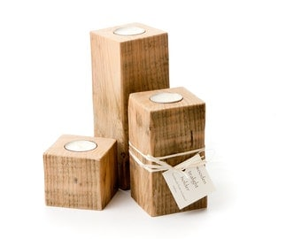Set of three natural wood tealight holders