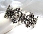 RESERVED FOR SUSAN..........Sterling Filigree Bracelet heavy vintage 1940's