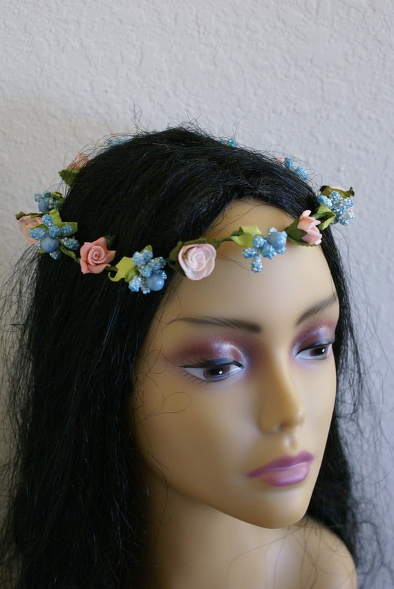 Head band , crown with blue and pink  flower
