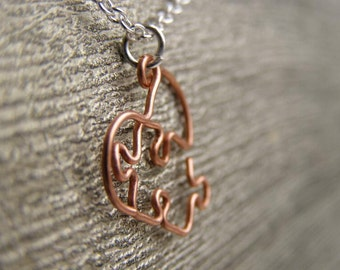 Puzzle Piece Heart Pendant in Raw Copper