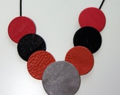 Coral red and black necklace, red black circles necklace, sunset pendant, tan leather, circles pendant, V shape
