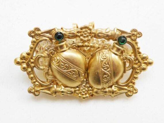 amber perfume bottle brooch