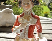 Two french vintage earthenware statuettes.