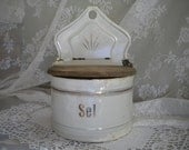 A french vintage white enamel salt box.