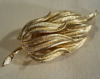 Coro brushed gold tone brooch