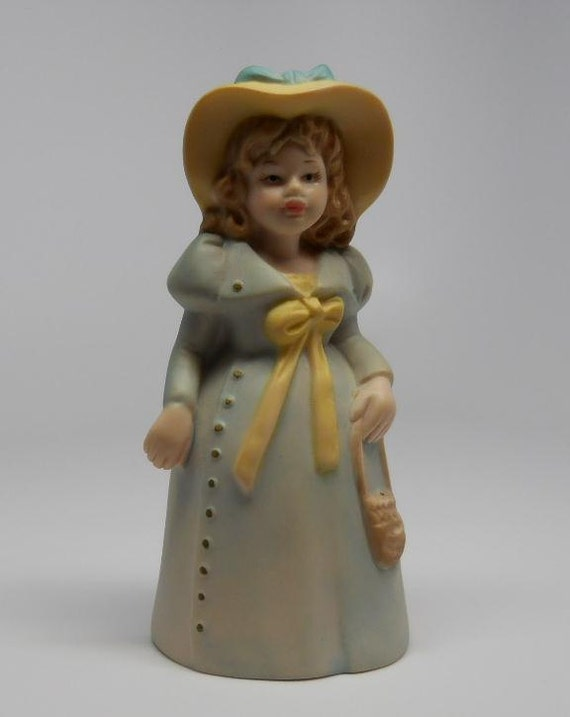 Vintage Old Fashioned Girl Bell Porcelain Figurine with Leg Clappers Blue Dress Yellow hat