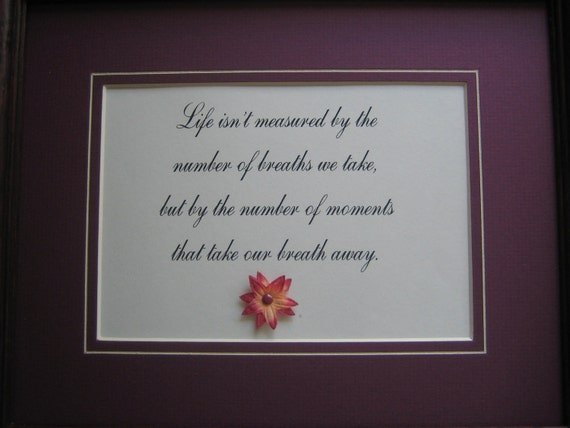 Framed quote about life 10x12 - Life isn't measured by the number of breaths we take, but by the number of moments that take our breath....