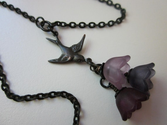 Bouquet - Victorian swallow bird charm, bouquet of rose and lilac lucite flowers, and antiqued black brass necklace