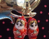 Cute red babushka earings with silver hooks and fittings.