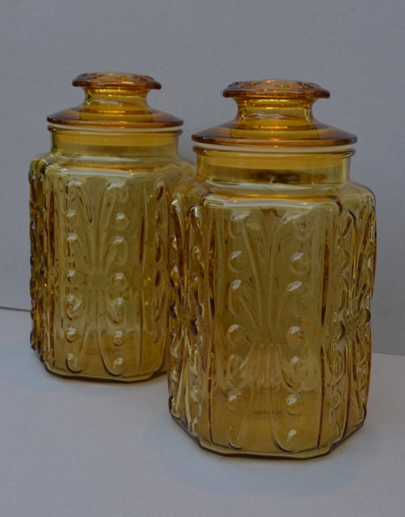 Two Vintage Amber Glass Atterbury Scroll Pattern Canisters
