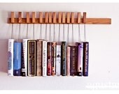 Custom made wooden book rack / bookshelf in Oak. The pins are also bookmarks. - OldAndCold