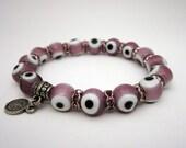 "Pink Evil Eye ""Nazar Bonuck"" Glass Bead Bracelet with Pink Swarovski spacer beads. Ottoman coin."