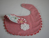 Gingham red and floral reversible baby bib
